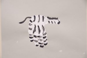 zebra painting made with child hand print