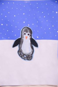 penguin painting made from a child's footprint